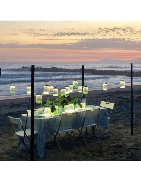 Lampe solaire sans fil SONNENGLAS® Valente Design sur plage